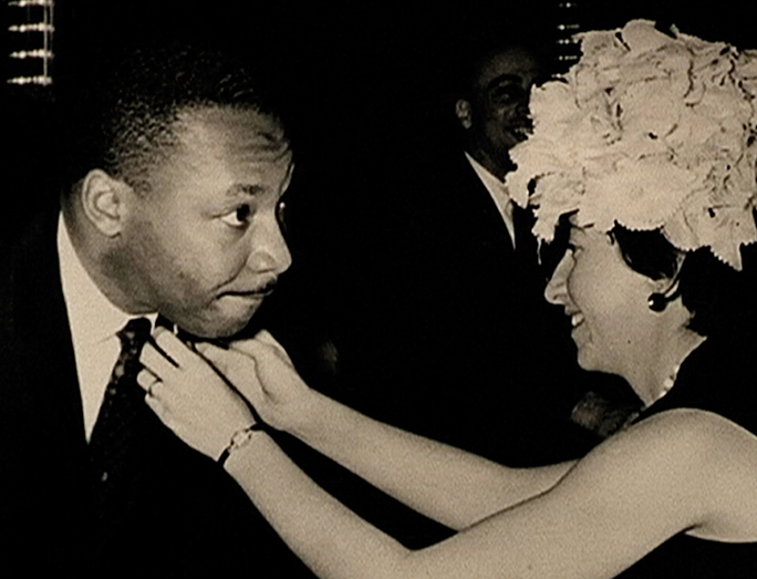 Nina, who was both a social activisit and a political wife, straightens the tie of Dr. Martin Luther King Jr. (Franz Leichter)