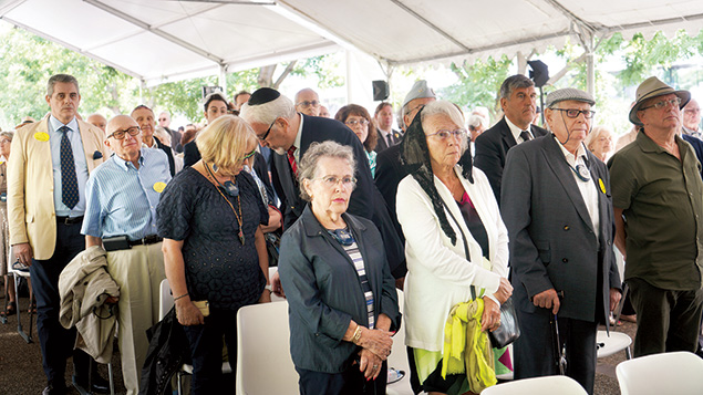 Audience members listen to French President Emmanuel Macron near the Vel d'Hiv memorial in Paris on July 16. (Cnaan Liphshiz)