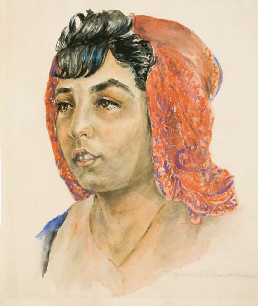 """A portrait of a young Roma woman, an inmate of the Nazi German death camp of Auschwitz, drawn by another inmate, Dina Gottliebova, a Jew from Czechoslovakia, on display at the """"Face to Face. Art in Auschwitz"""" exhibition of art by inmates shown at the Szolayski house in Krakow, Poland, July 12, 2017 (Bartosz Bartyzel/Auschwitz Museum via AP)"""