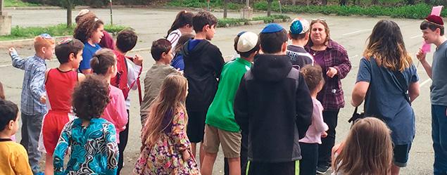 Rabbi Estelle Mills talks to students outside the New Jersey Jewish Academy.