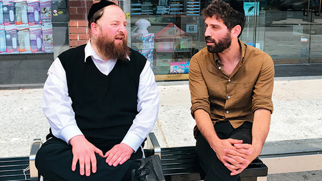 Actor Menashe Lustig sits with director Joshua Z Weinstein. (Abraham Riesman)