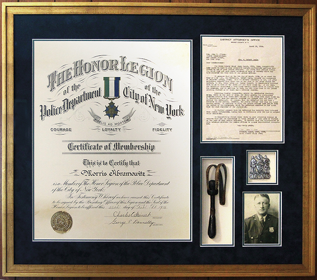 The memorabilia of Morris Abromowitz's career as a New York policeman include the proclamation of his membership in the NYPD's Honor Legion, a 1934 letter from the Bronx's district attorney, his police badge, and his slapstick.