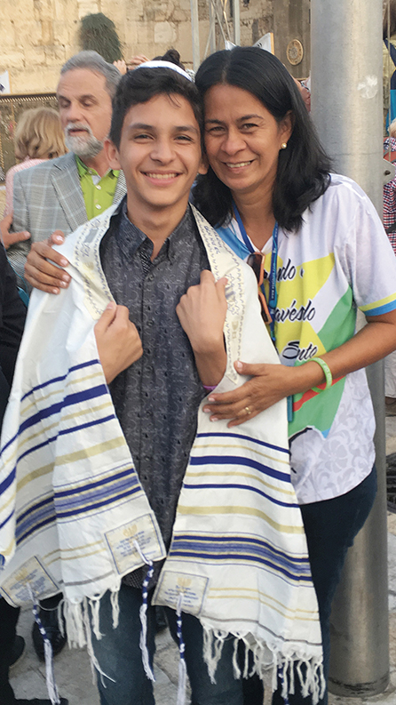 Mickey was so moved by a bar mitzvah at the Kotel that after he cried he photographed the boy and his mother in the plaza.