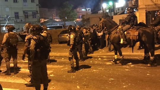 Police confront rioters in Jaffa on August 8, 2017. (Israel Police)