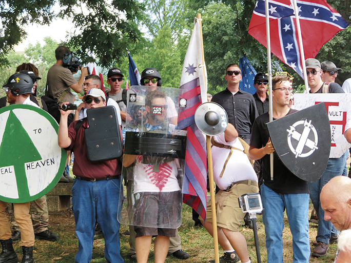 White supremacists carry shields at Charlottesville.