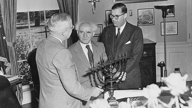 In the Oval Office, David Ben-Gurion, center, and Israel's ambassador to the United States, Abba Eban, give President Harry S. Truman a menorah in 1951. U.S. National Archives and Records Administration