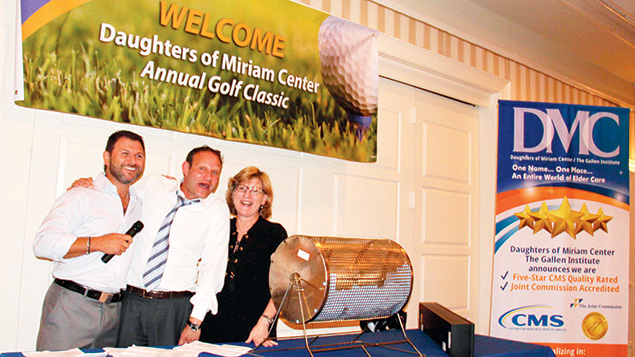 Golf Classic co-chairs, Alex Fleysher, left, and Leslie Levine, with Golf Shootout sponsor Robert Francis of Planned Companies. Mr. Francis won the raffle's grand prize, and donated it back to DOMC.