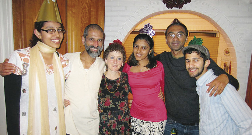 Celebrating with nieces and nephews, and with his son, Arun, at the far right.