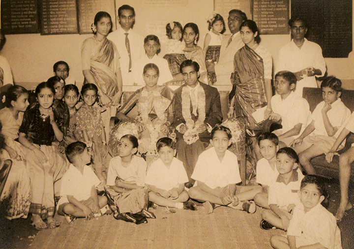 At his uncle's wedding, young Plachikkat Viswanath is sitting down, third from left. His parents are standing in the back, on the left.