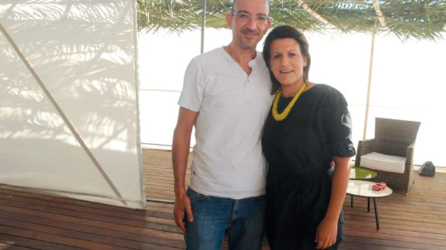 """In northern Israel, an Israeli-Arab couple hoped to build bridges Khalil and Reem Bakly, Muslim Arab dentists who live in Upper Nazareth, invited Jews and Arabs to eat together in their huge homemade sukkah. The sukkah is 100 percent up to Jewish religious standards: The pair ordered kosher food and got an Orthodox Jew to supervise the construction. """"My dream is for this to serve as a springboard for more and more gatherings of this type that will help foster a shared society for Jews and Arabs in this country,"""" Khalil told Haaretz."""
