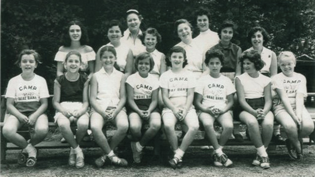 It's 1954 at Camp Brae Bank in Kinnelon. Seated, left to right, Cheryl Friedman, Gail Weiner, Ellen Opper, Anne Friedman, Ilene Shaft, Barbara Bornstein, Judy Sheldon, and Sharon Cosloy. Standing, left to right, Marilyn Green, Mickey Cohen, Karen Krug, Sissy Tanenbaum, Barbara Sonofsky and Jenny Katz. Anne Marie Patterson and Joanne Weisser are the counselors.