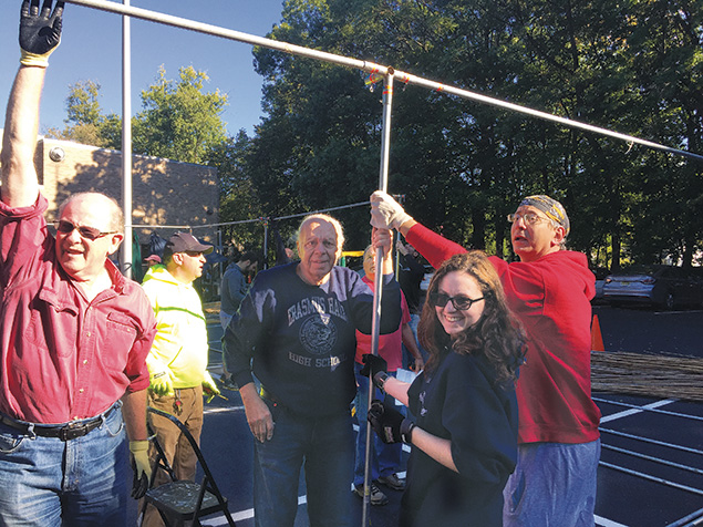 Members of the Glen Rock Jewish Center helped with sukkah construction while its Hebrew school did the decorating. (Courtesy GRJC)