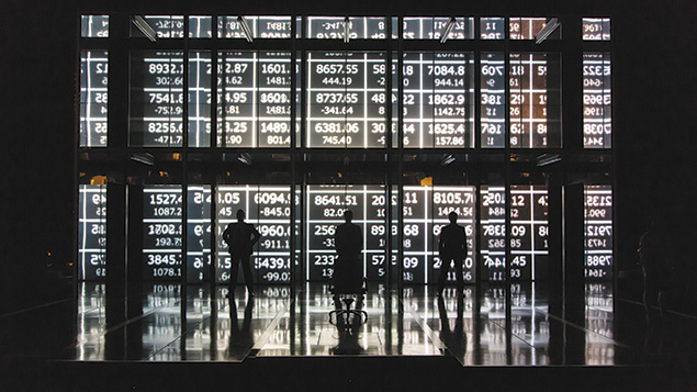 """Minimalist sets of the financial world add to the tension of """"Junk,"""" now playing at Lincoln Center."""
