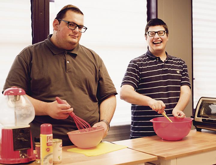 Moshe Rosenberg and Mendel Reis of Yachad work on their culinary skills.
