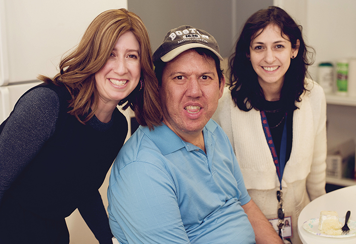Yachad New Jersey's director, Chani Herrmann, left, and Leora Verbit, vocational coordinator at the Mendel Balk Yachad Center, flank Yachad participant Donny Hain.